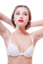Brunette young woman with red lips in white underwear is looking to the side on a white copy space background isolated Royalty Free Stock Photo