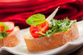 Bruschetta with Arugula and Tomatoes Royalty Free Stock Image