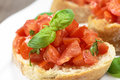 Bruschetta with basil on wooden table Royalty Free Stock Photos