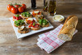Bruschetta with beans and arugula mushrooms goat cheese on a wooden board Royalty Free Stock Photography