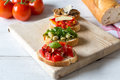 Bruschetta with beans and arugula mushrooms goat cheese on a wooden board Royalty Free Stock Photo