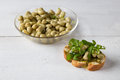 Bruschetta with beans and rocket arugula on a wooden board Royalty Free Stock Images