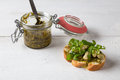 Bruschetta with beans and rocket arugula on a wooden board Stock Photos