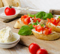 Bruschetta with fresh tomatoes cheese and basil selective focus Royalty Free Stock Photos