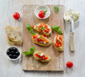 Bruschetta with fresh tomatoes cheese and basil selective focus Stock Photo