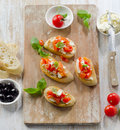 Bruschetta with fresh tomatoes cheese and basil selective focus Royalty Free Stock Image