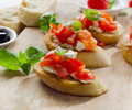 Bruschetta with fresh tomatoes cheese and basil selective focus Stock Images