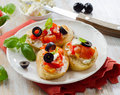 Bruschetta with fresh tomatoes olives and basil selective focus Stock Image