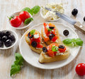 Bruschetta with fresh tomatoes olives and basil selective focus Stock Photos