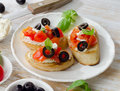 Bruschetta with fresh tomatoes olives and basil selective focus Royalty Free Stock Image