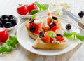 Bruschetta with fresh tomatoes olives and basil selective focus Stock Photography