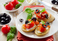 Bruschetta with fresh tomatoes olives and basil selective focus Royalty Free Stock Images