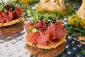 Bruschetta on gourmet wheat crackers thin toast with assorted appetizers Stock Photography