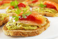 Bruschetta with Guacamole, Smoked Salmon Royalty Free Stock Photos