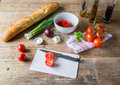 Bruschetta ingredients for preparation on wood Royalty Free Stock Photography