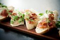 Bruschetta with parma ham and melon Stock Photos