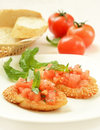Bruschetta with tomato and basil on white plate Royalty Free Stock Images