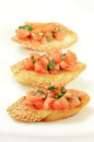 Bruschetta with tomato and basil on white plate Stock Images