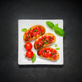 Bruschetta with Tomato and Basil on White Plate Royalty Free Stock Photo