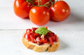 Bruschetta with tomato tomatoes on a wooden board Royalty Free Stock Image