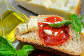 Bruschetta and tomatoe sauce with fresh basil olive oil Royalty Free Stock Image