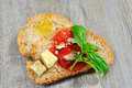 Bruschetta and tomatoe sauce with fresh basil olive oil Stock Photos