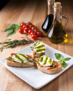Bruschetta on a white plate Royalty Free Stock Photo