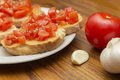 Bruschetta wood table with garlic and tomato Stock Photography