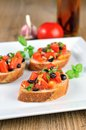 Bruschetta on wooden table and white plate tasty Stock Photo