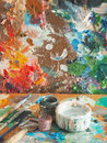 Brush and bright oil-paint palette for background Royalty Free Stock Photo