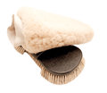 Brush with natural bristle and sheepskin mitten Royalty Free Stock Photo