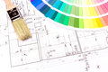 Brush for paint over house plan on architect s workplace with blueprints color samples and brushes Stock Images