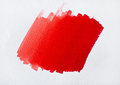 Brush red color on white paper Royalty Free Stock Photography