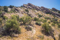 Brush and rock of mojave desert formations in the wilderness the Royalty Free Stock Photography