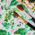 Brushes and hand made watercolor abstract floral background. Romantic concept of spring, lifestyle, hobbies. Top view Royalty Free Stock Photo