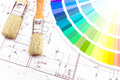 Brushes for paint over house plan architect s workplace with blueprints color samples and Stock Image