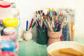 Brushes and paints of art painter in his studio Royalty Free Stock Photo