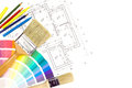 Brushes pencil and color samples paintbrushes colorful paint on house plan blueprint background Stock Photos