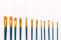 Brushes on white wooden background