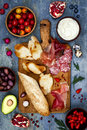 Brushetta or authentic traditional spanish tapas set for lunch table. Sharing antipasti on party picnic time on blue background Royalty Free Stock Photo