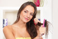 Brushing hair pretty girl in home setting Royalty Free Stock Image