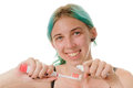 Brushing teeth close up of a smilng young woman about to brush Stock Photos