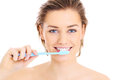 Brushing teeth a picture of a young pretty woman her over white background Stock Photo