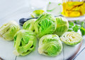 Brussel sprouts on board and on a table Royalty Free Stock Photo