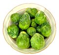 Brussel sprouts in a bowl on a white background Royalty Free Stock Photo
