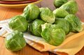 Brussel sprouts fresh raw brussels drying on a kitchen towel Royalty Free Stock Photography
