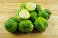Brussel sprouts in a pile of on wooden chopping board Royalty Free Stock Images