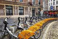 Brussels, Belgium, 10/13/2019: Parking of urban bikes in a square in the city center Royalty Free Stock Photo