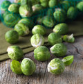 Brussels sprouts cabbage on old wooden table Royalty Free Stock Images