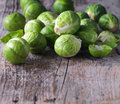 Brussels sprouts cabbage on old wooden table Stock Photos